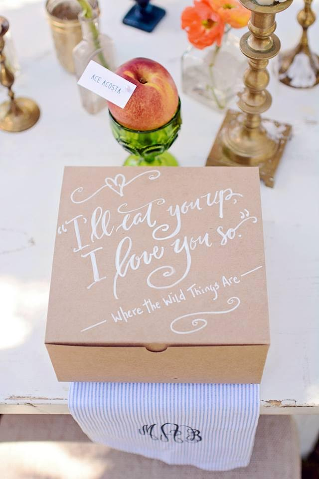 """""""I'll Eat You Up. I love you so."""" A sweet message written in script decorates the lids of individual craft paper food boxes."""